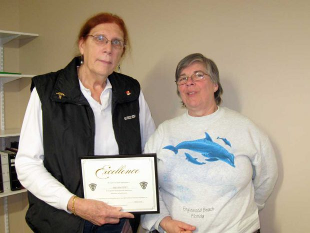 Megan Posey Presented with Certificate